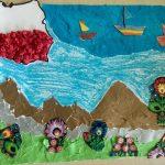 Praca plastyczna przedstawiająca mapęPolski, góry, morze, kwiaty.